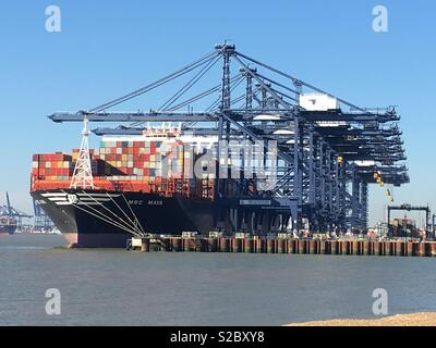 A container ship being unloaded at Felixstowe. - Stock Image
