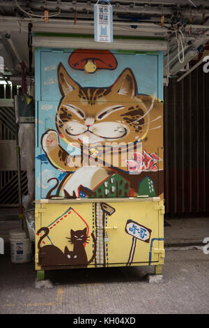 Closed Market Stall.  Exterior is painted with a picture of a cat. - Stock Image