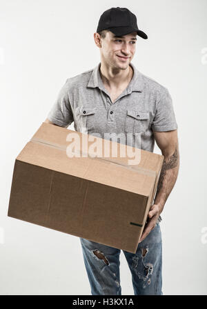 Courier hands of boxes, packages - Stock Image