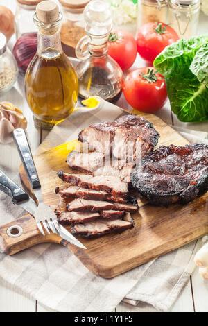 Char Siu Pork - Chinese roasted pork shoulder or pork belly on cutting board - Stock Image