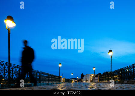 Roman bridge over the Gilao river, Tavira, Algarve, Portugal - Stock Image
