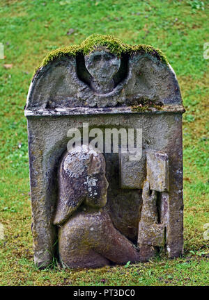 Gravestone with image of person reading a book. Dryburgh Abbey. Dryburgh, St.Boswells, Roxburghshire, Scottish Borders, Scotland, United Kingdom. - Stock Image
