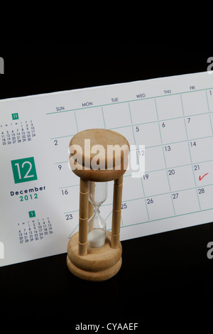 Calendr marked on December 21st 2012 the Mayan Judgment Day with a sand timer - Stock Image
