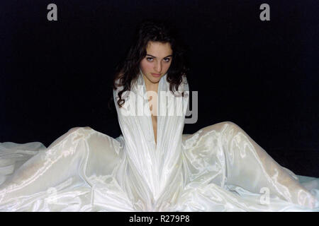 Young woman wrapped in a large white satin robe 1980s hungary - Stock Image