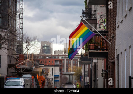 MONTREAL, CANADA - NOVEMBER 8, 2018: Rainwbow gay flag hanging in Le Village, the gay district of the city center of Montreal, Quebec, in an area that - Stock Image