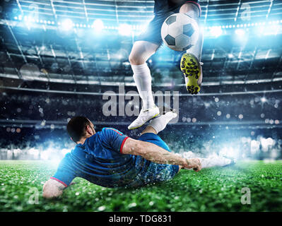 Soccer players with soccerball at the stadium during the match - Stock Image