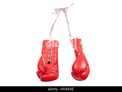 used and battered red leather boxing gloves, isolated on white background - Stock Image