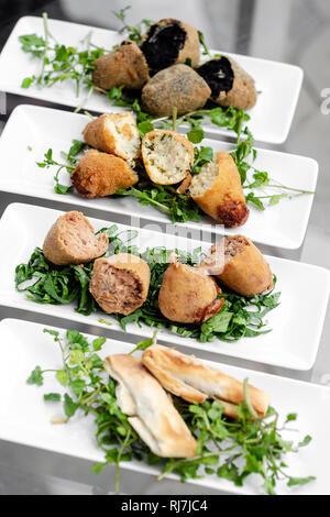 selection of traditional portuguese tapas snacks on lisbon restaurant table - Stock Image