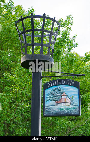 Mundon village sign and signal  fire basket - Stock Image