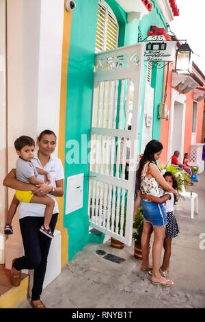 Cartagena Colombia Old Walled City Center centre Getsemani Hispanic residents neighborhood woman boy girl child mother son daughter standing outdoors - Stock Image