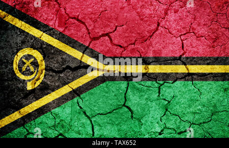 Republic of Vanuatu flag on dry earth ground texture background - Stock Image