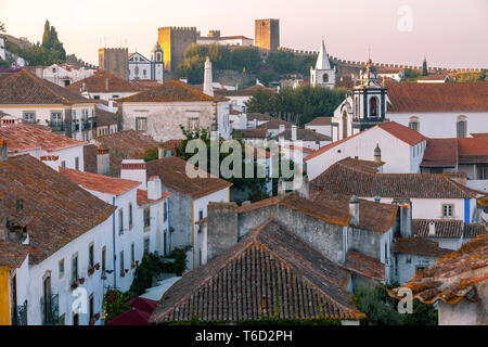 Obidos at dusk, one of the most beautiful medieval villages in Portugal, taken to the moors in the 12th century. - Stock Image