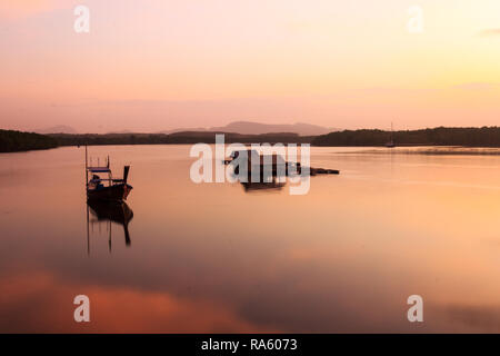Boat and fish hut on river estuary at dawn, Pak Meng, Trang, Thailand - Stock Image