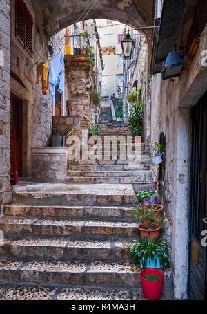 Through the streets of the old historic part of the fortress city.  Stone stairs leading up to the upper part of the city - Stock Image