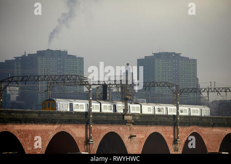 Northern las 319 local train crossing Stockport landmark Viaduct on rout to Manchester - Stock Image