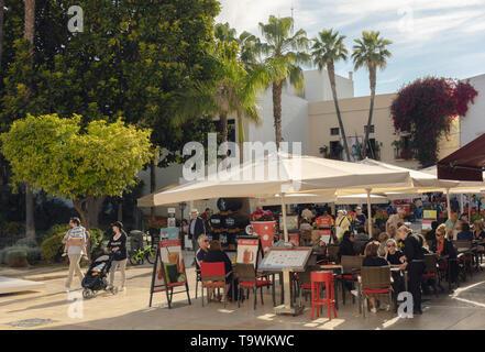 Customers enjoying drinks on terrace of Bar El Pimpi on the corner of calle Zegri and Calle Alcazabilla, Malaga, Costa del Sol, Malaga Province, Andal - Stock Image
