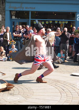 'Tosspot' character in the Midgley Pace Egg Play traditional mummers play at Hebden Bridge flashing Union Jack boxer shorts - Stock Image