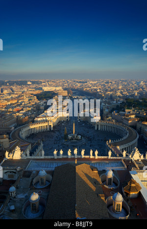 View across Rome from the top of St. Peter's Dome, Vatican City, including St.Peter's square at dusk, with - Stock Image