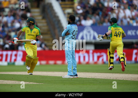 Birmingham, UK. Birmingham, UK. 11th July 2019; Edgbaston, Midlands, England; ICC World Cup Cricket semi-final England versus Australia; Adil Rashid watches the ball head for the boundary as Glenn Maxwell and Steve Smith run between wickets Credit: Action Plus Sports Images/Alamy Live News - Stock Image