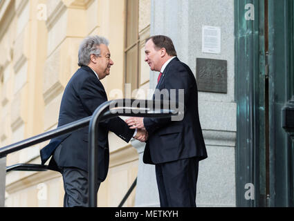 Stockholm, Sweden, 23th April, 2018. UN Secretary-General and Security Council to meet in Sweden. UN Secretary-General António Guterres visiting the National Library of Sweden.Prime Minister Stefan Löfven welcomes António Guterres (left) outside the entrance to the National Library of Sweden.   Credit: Barbro Bergfeldt/Alamy Live News - Stock Image