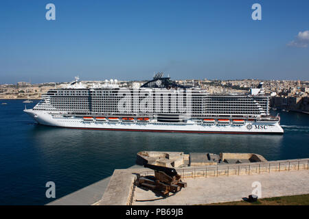 The large modern cruise ship or liner MSC Seaview, belonging to MSC Cruises, departing Malta's Grand Harbour. Holiday travel in the Mediterranean Sea. - Stock Image