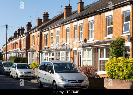 Terraced brick housing, concept - the UK housing market and economy - Stock Image