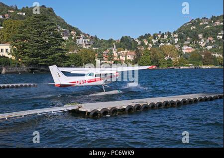 Cessna seaplane taking off in Lake of Como, Italy - Stock Image