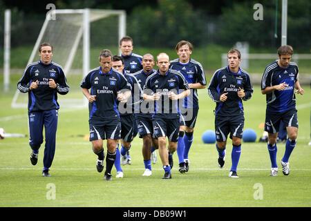 HSV Hamburg players (L-R) and assistant coach Markus Schupp, Piotr Trochowski, goalkeeper Frank Rost, Nigel de Jong, - Stock Image