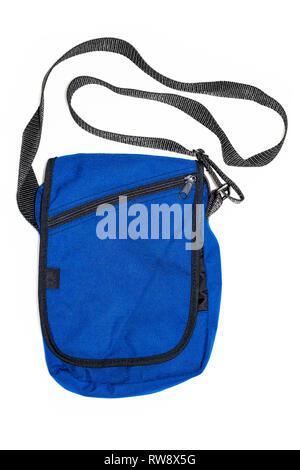 Blue nylon unisex shoulder bag cutout and isolated on a white background - Stock Image