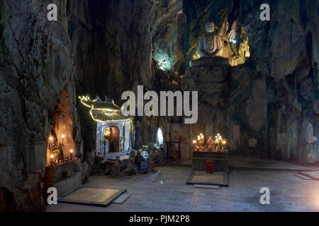 Buddhist temple within Huyen Khong Cave in the Marble Mountains, halfway between Hoi An and Da Nang, Vietnam. The temple is part of a complex of caves - Stock Image