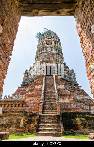 Large ancient pagoda looking through the door frame of Wat Chaiwatthanaram is buddhist temple, famous and major - Stock Image