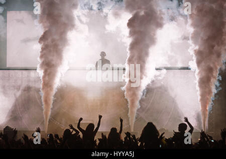 3 August 2013 - Santander, Spain - Scottish DJ Calvin Harris (standing above the audience, centre) performs during - Stock Image