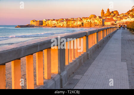 Beautiful view of the beach, Cefalu Cathedral and old town of coastal city Cefalu at sunset, Sicily, Italy - Stock Image