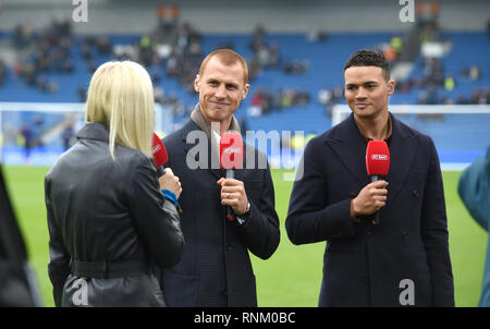 The BT television team of Steve Sidwell and Jermaine Jenas during the FA Cup 5th round match between Brighton & Hove Albion and Derby County at the American Express Community Stadium . 16 February 2019 Photograph taken by Simon Dack  Editorial use only. No merchandising. For Football images FA and Premier League restrictions apply inc. no internet/mobile usage without FAPL license - for details contact Football Dataco - Stock Image