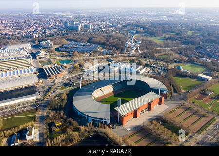 King Baudouin National Football and Rugby Stadium aerial view feat. The Atomium landmark building in city center Brussels, Belgium - Stock Image