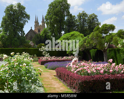 Flower gardens at the historic medieval grounds and buildings of Penhurst Place. - Stock Image
