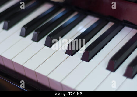 Classical piano keyboard black and withe, musical keys and instrument. Music concept background. Close up, selective focus - Stock Image