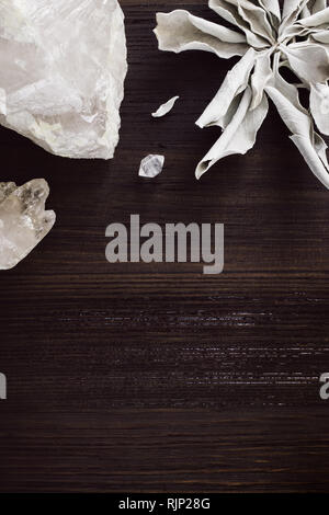 White Sage and Quartz on Dark Wood with Lower Space for Copy - Stock Image