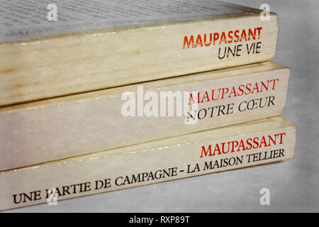 Three French books by Guy de Maupassant (1850-1893) including two novels (top two books) and two short stories (bottom book) - Stock Image