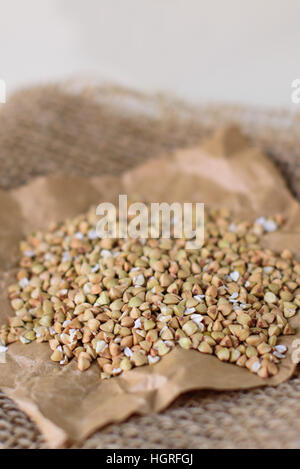 Buckwheat on white wooden background, close - up - Stock Image