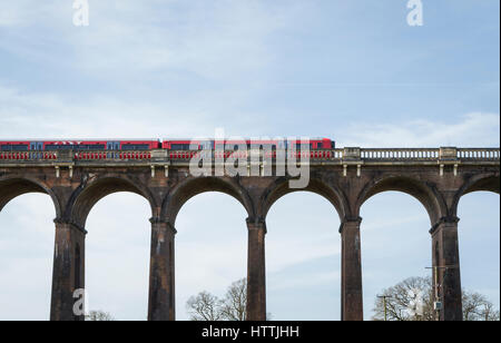 View of Gatwick Express train travelling over the Ouse Valley (Balcombe) Viaduct, West Sussex, UK - Stock Image