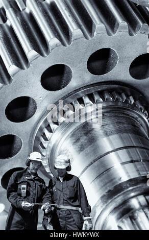 industry workers and gears machinery - Stock Image