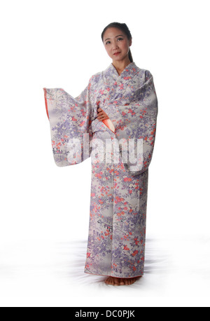 Japanese Lady Wearing a Pink and Lilac Patterned Kimono - Stock Image