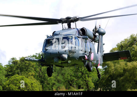 An HH-60G Pave Hawk helicopter from the 129th Rescue Squadron from Moffett Air National Guard Base, California, - Stock Image