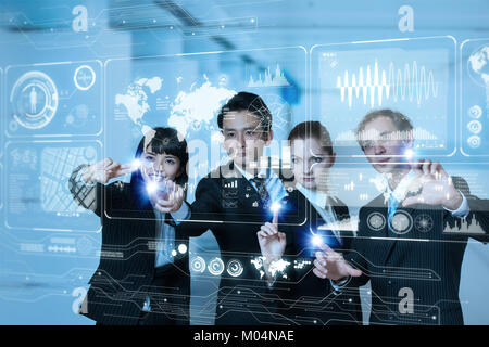 Group of people operating futuristic GUI. - Stock Image