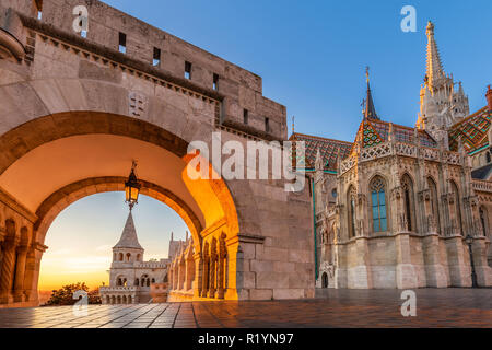 Budapest, Hungary - Entrance of Buda District with the beautiful Matthias Church at golden sunrise and clear blue sky - Stock Image