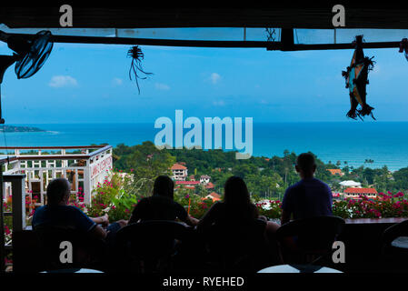 Silhouettes of people relaxing in bar on observation deck Lamai view point, Samui, Thailand - Stock Image