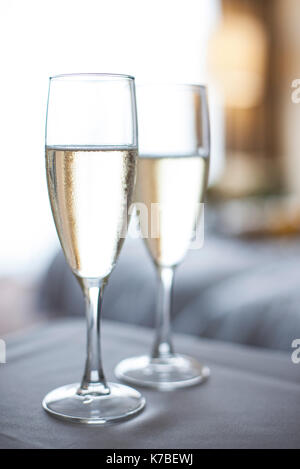 Champagne in champange flutes - Stock Image