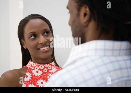African man smiling at girlfriend - Stock Image