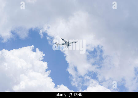 Airplane in the clouds - Stock Image